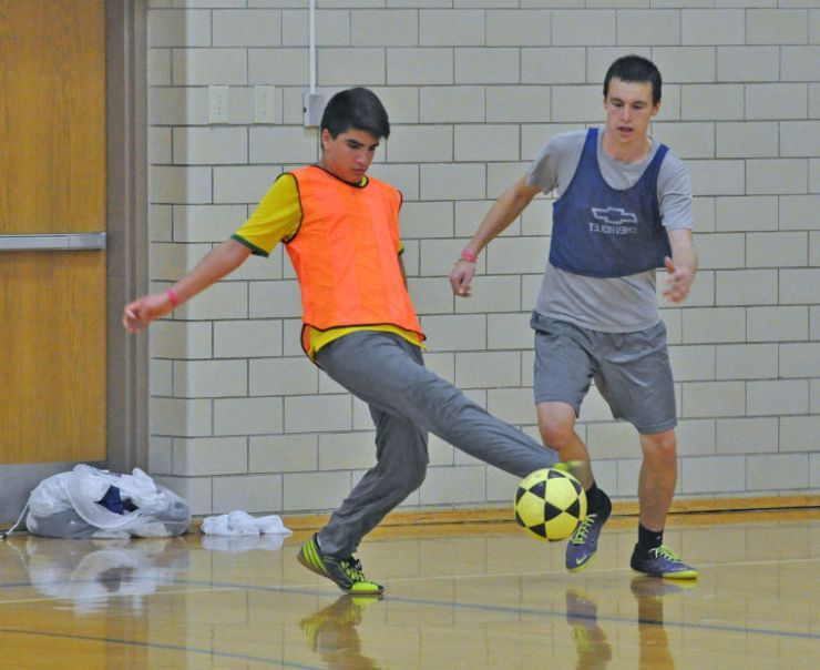 Matheus Moreira, a foreign-exchange student at Litchfield High School, passes the ball during community education soccer on Oct. 7.